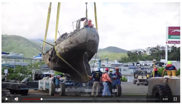 Hurricane response crews in Puerto Rico move wrecked vessels off crane barge