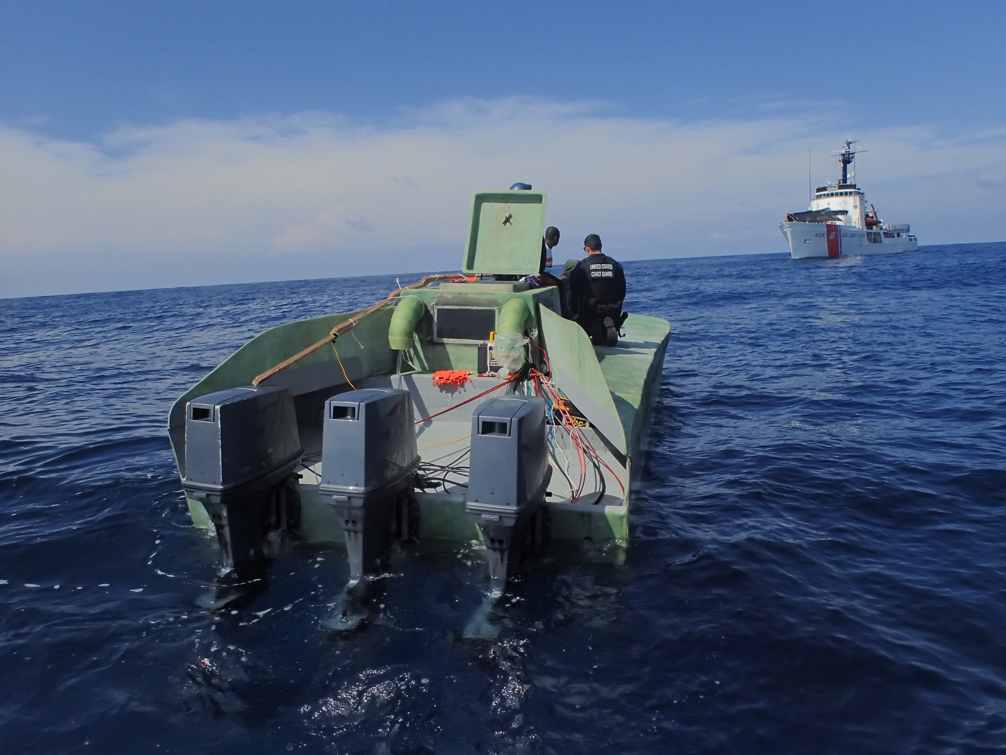 Coast Guard Cutter Steadfast intercepts suspected drug smuggling low profile vessel