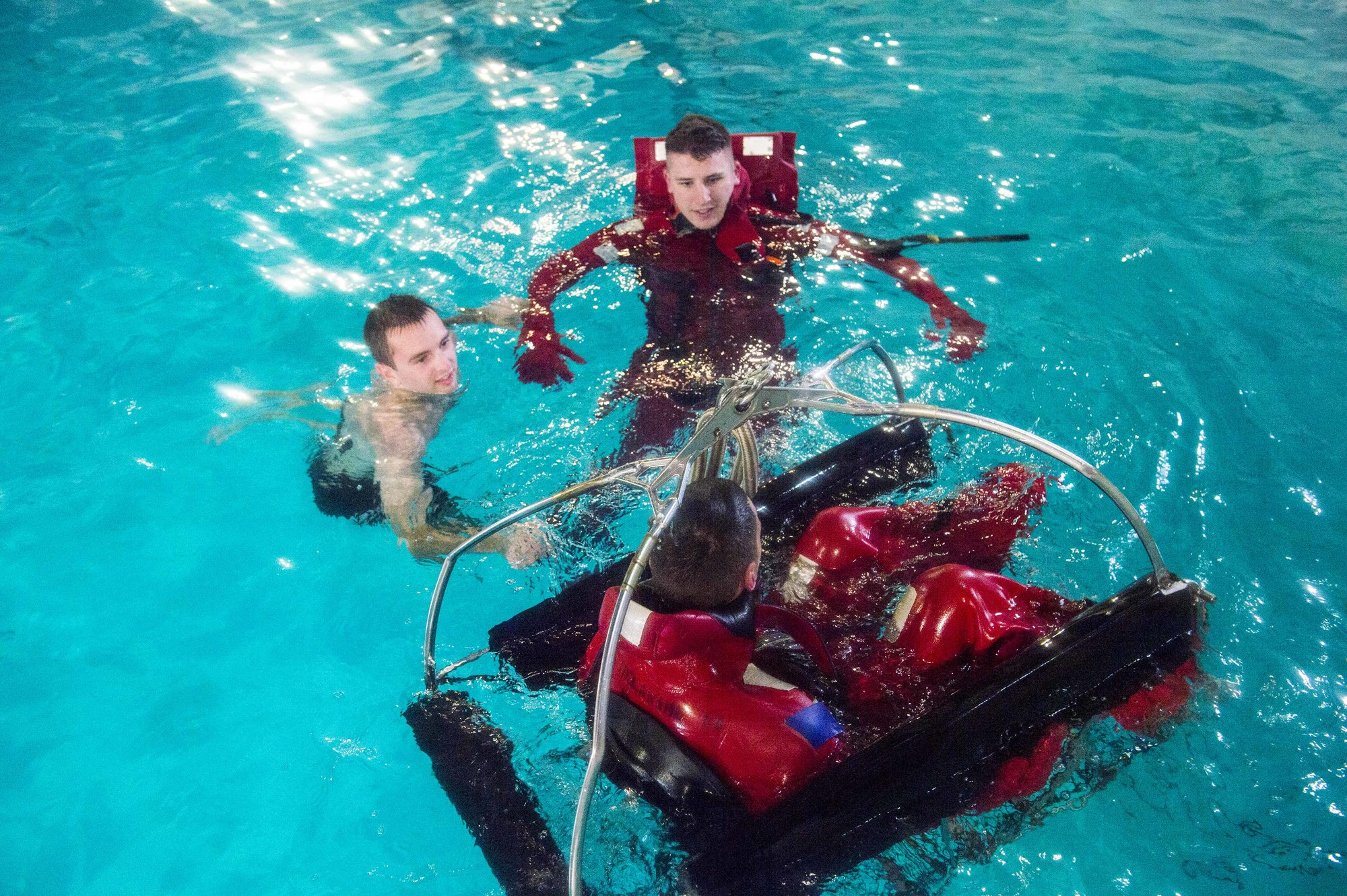 Coast Guard Academy Mechanical Engineering cadets test out their new rescue basket design at a local simulator facility, April 18, 2018.