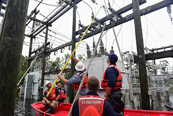 Shallow water crews assist power company workers