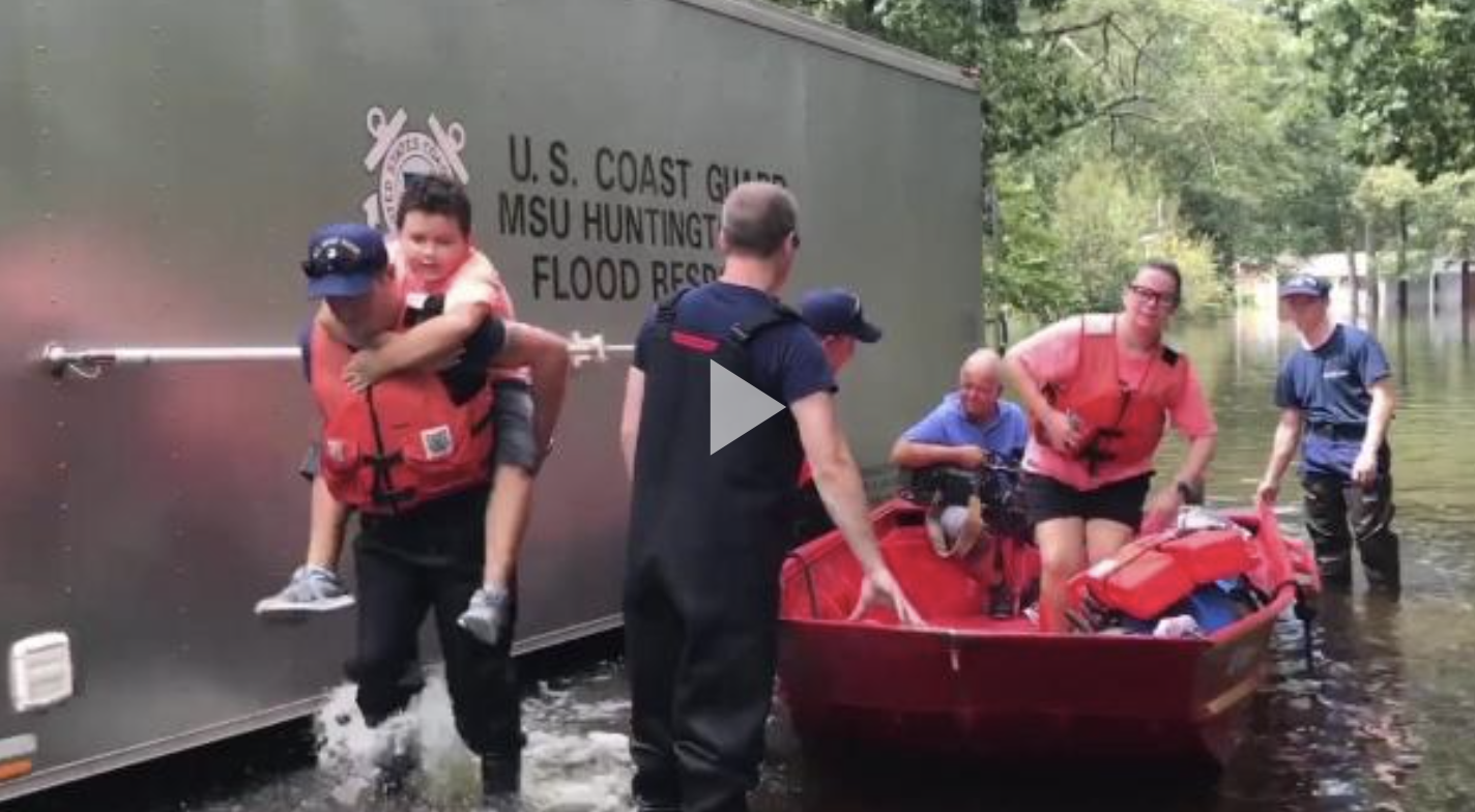 Coast Guard shallow-water response boat team crew members rescue people trapped by floods