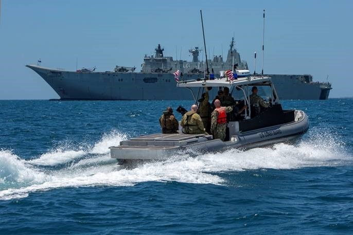Coast Guard servicemembers conduct maritime security enforcement during APEC