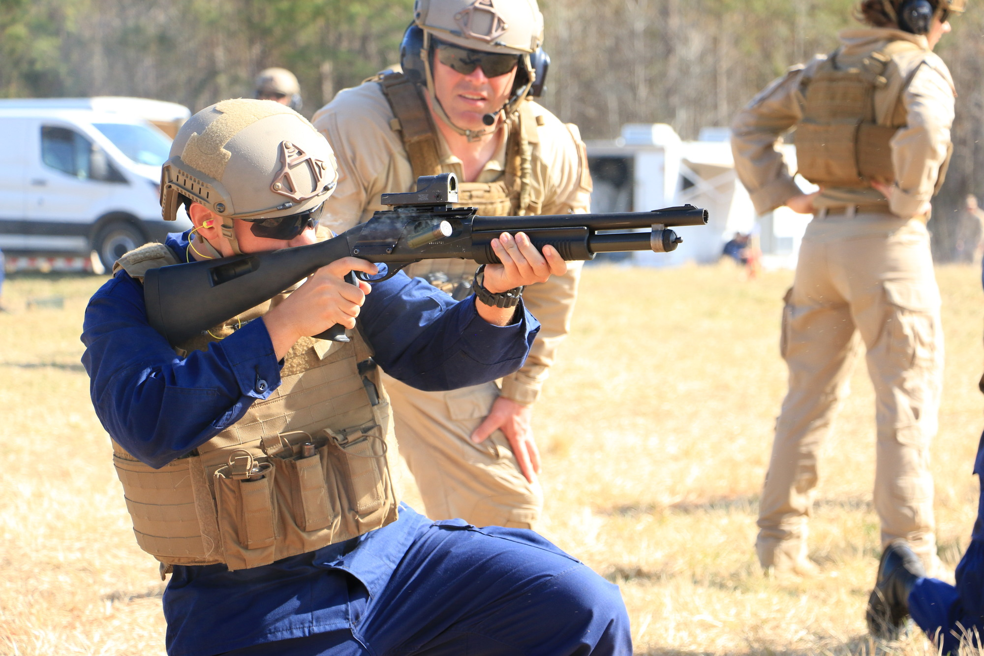 A Coast Guard special missions trainee fires the M870 Shotgun during a training exercise