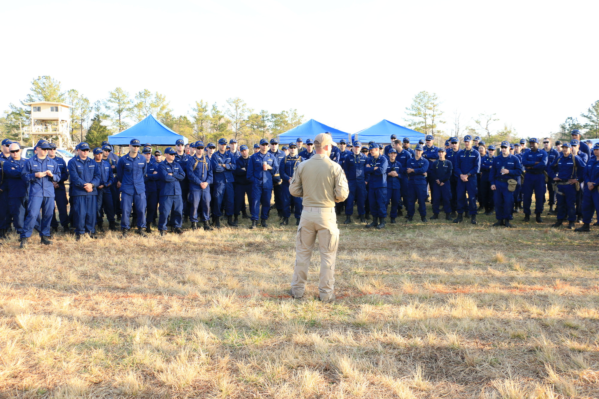 A Chief Maritime Enforcement Specialist briefs Special Missions Training Center class 19-01