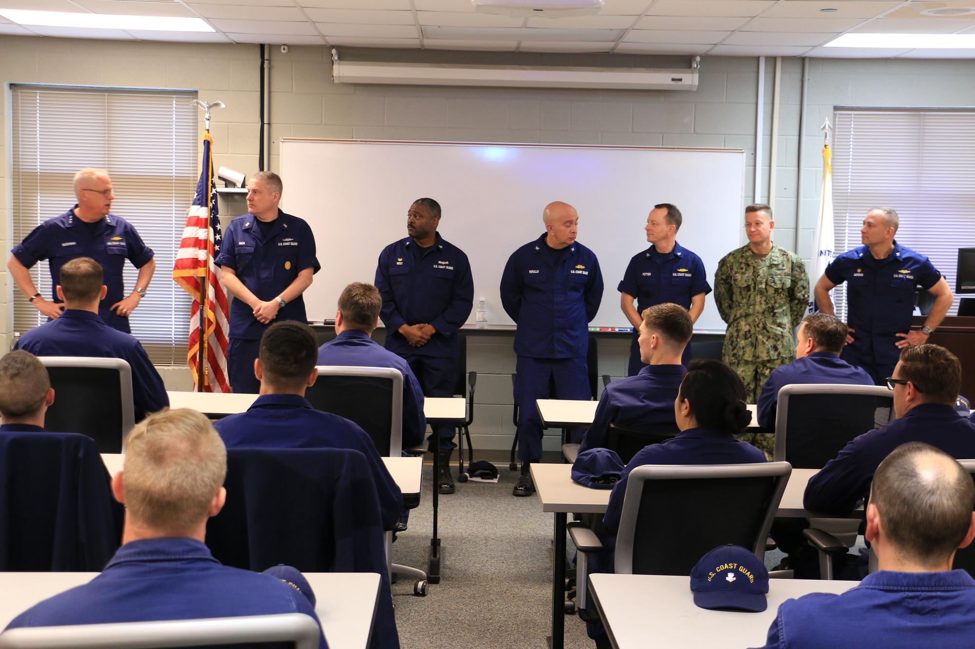 Vice Adm. Scott A. Buschman speaks during a Special Missions Training Center pre-deployment class graduation