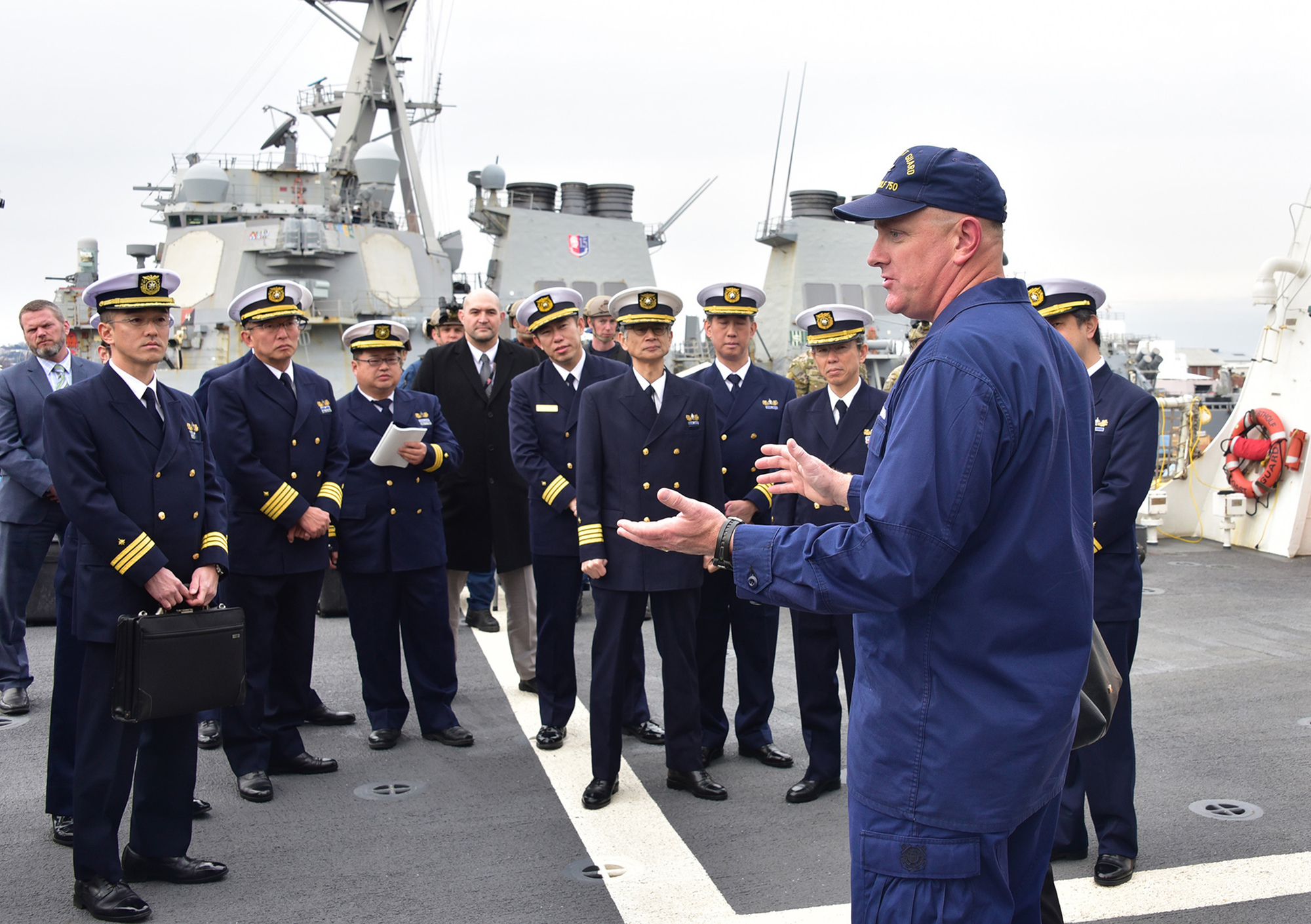 Capt. John Driscoll, commanding officer of U.S. Coast Guard Cutter Bertholf (WMSL 750), addresses officers from Japan coast guard on the ship's flight deck Feb. 7, 2019. Bertholf is on a deployment to the Western Pacific Ocean in support of the U.S. Navy's 7th Fleet. U.S. Coast Guard photo by Chief Petty Officer John Masson