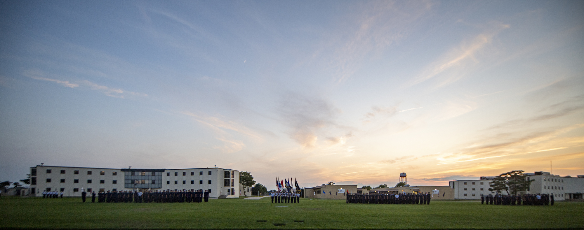Recruits at U.S. Coast Guard Training Center Cape May stand in formation during a Sunset Parade on base Aug. 4, 2019.