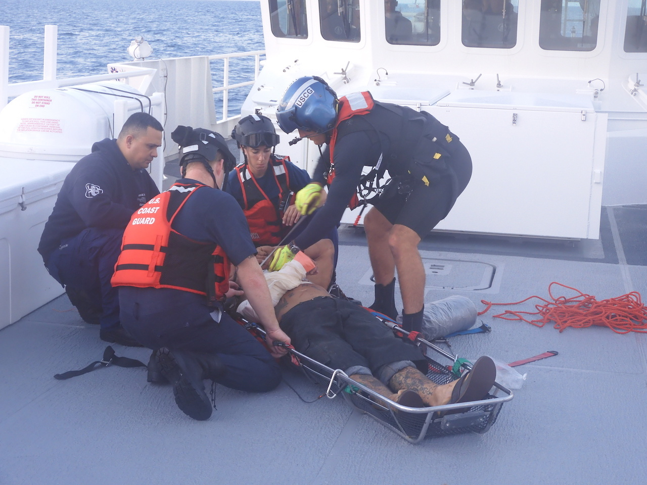 PHOTO RELEASE: Coast Guard medevacs 2 after boat collision 35 miles northwest of Dry Tortugas