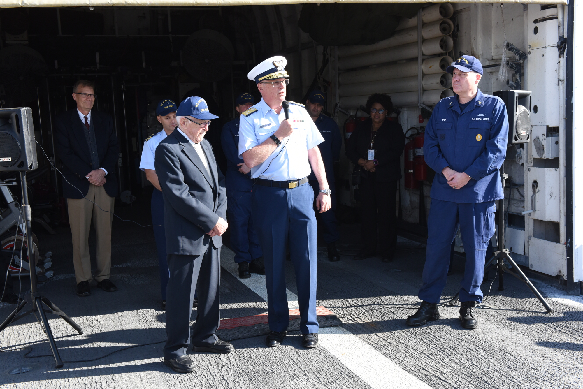Alex Obrizok, a 96-year-old Coast Guard veteran meets Vice Adm. Scott Buschman, Coast Guard Atlantic Area Commander, on the Coast Guard Cutter Tampa