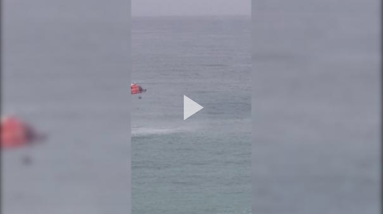 A Coast Guard Air Station Borinquen MH-65 Dolphin helicopter crew rescued two kayakers Dec. 1, 2019, in waters just off Ocean Park Beach in San Juan, Puerto Rico.