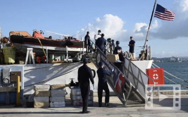 Crewmembers of the Coast Guard Cutter Bear (WMEC-901) offload 3,086 pounds of cocaine Feb. 4, 2020 in San Juan, Puerto Rico.