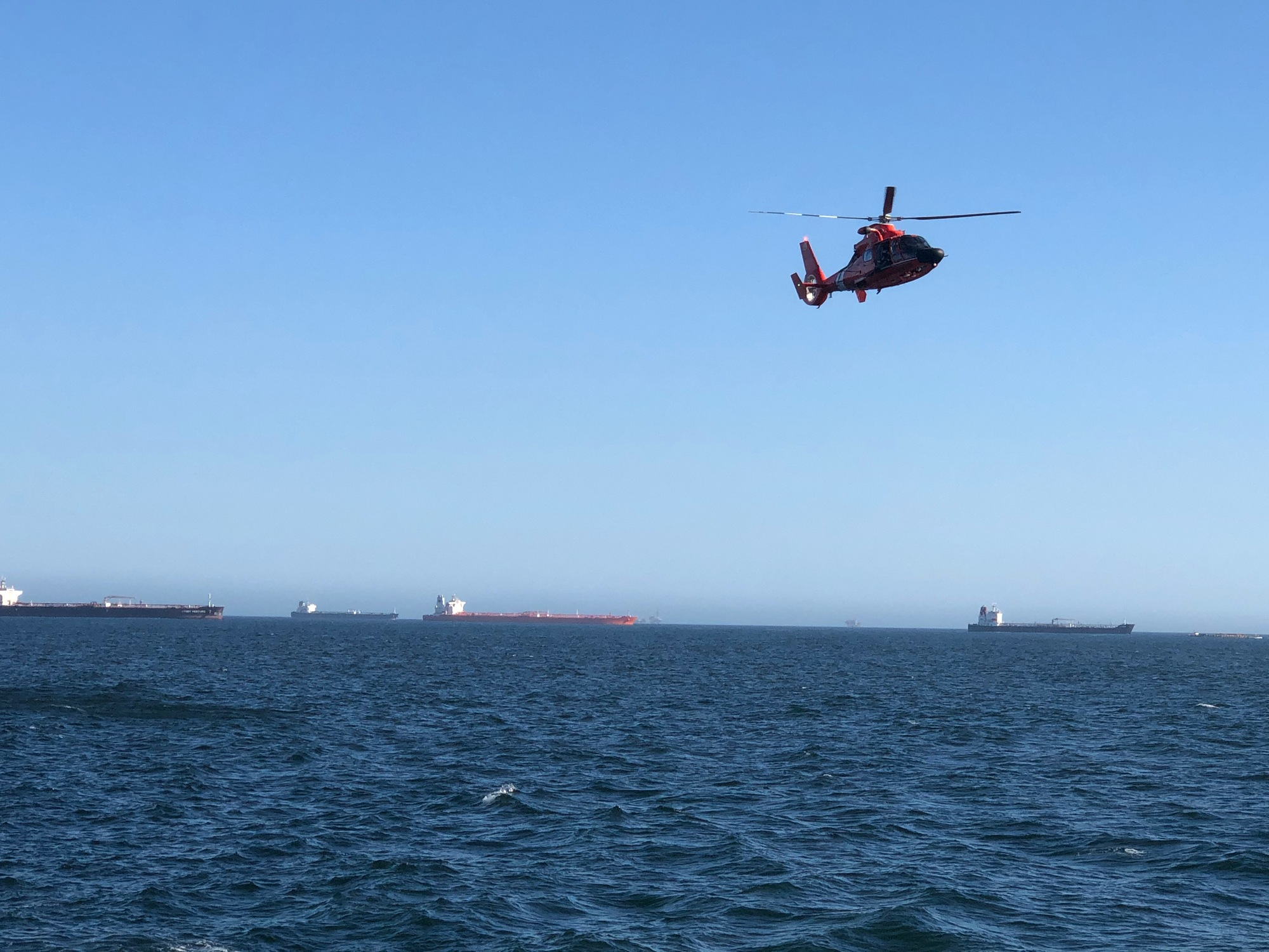 MH-65 Dolphin helicopter flying off coast of SoCal