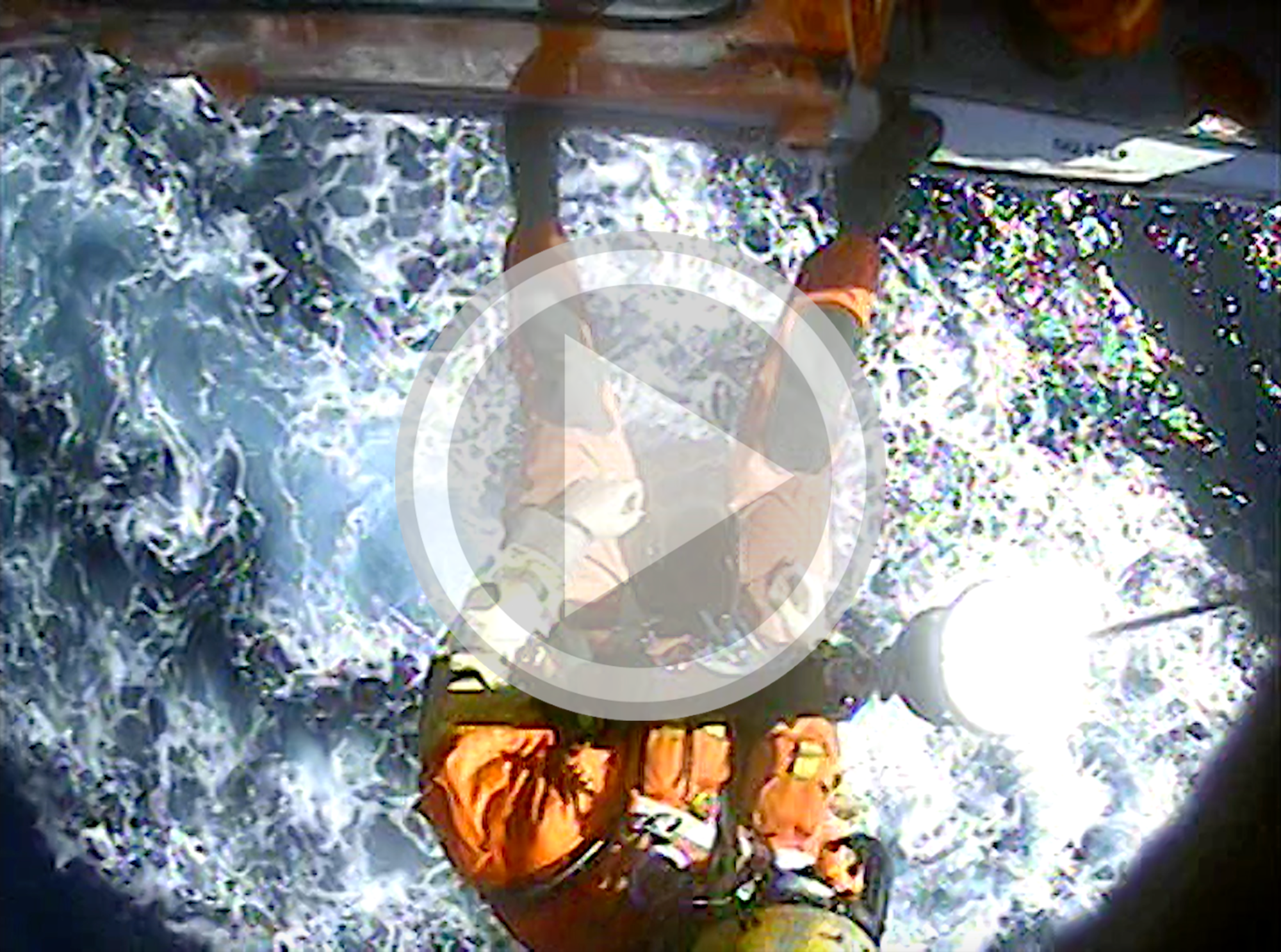 The crew aboard an Air Station San Francisco MH-65 Dolphin helicopter medevac a 19-year-old man from the fishing vessel Ginger approximately 8 miles west of San Nicolas Island, Calif., June 20, 2020. The crew transported the patient to Torrance Memorial Hospital in Torrance, Calif. (U.S. Coast Guard video)