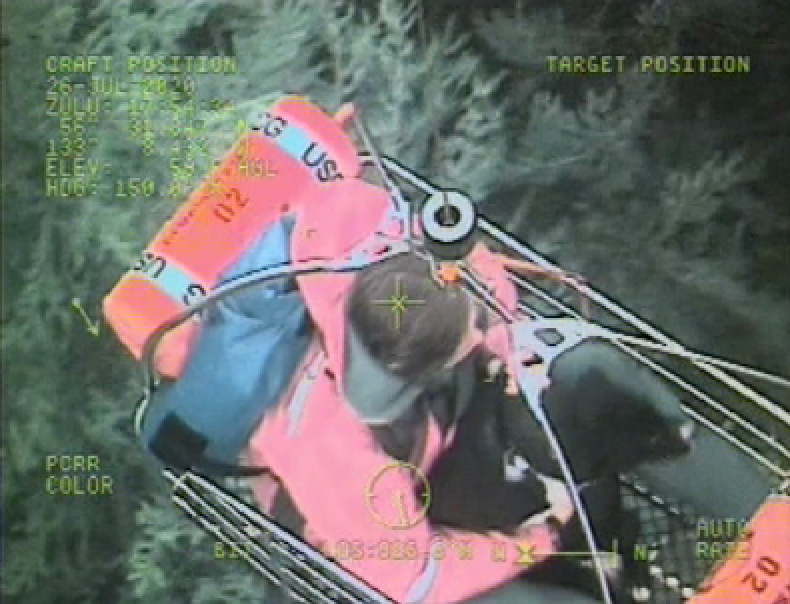 Coast Guard rescues two people and two dogs