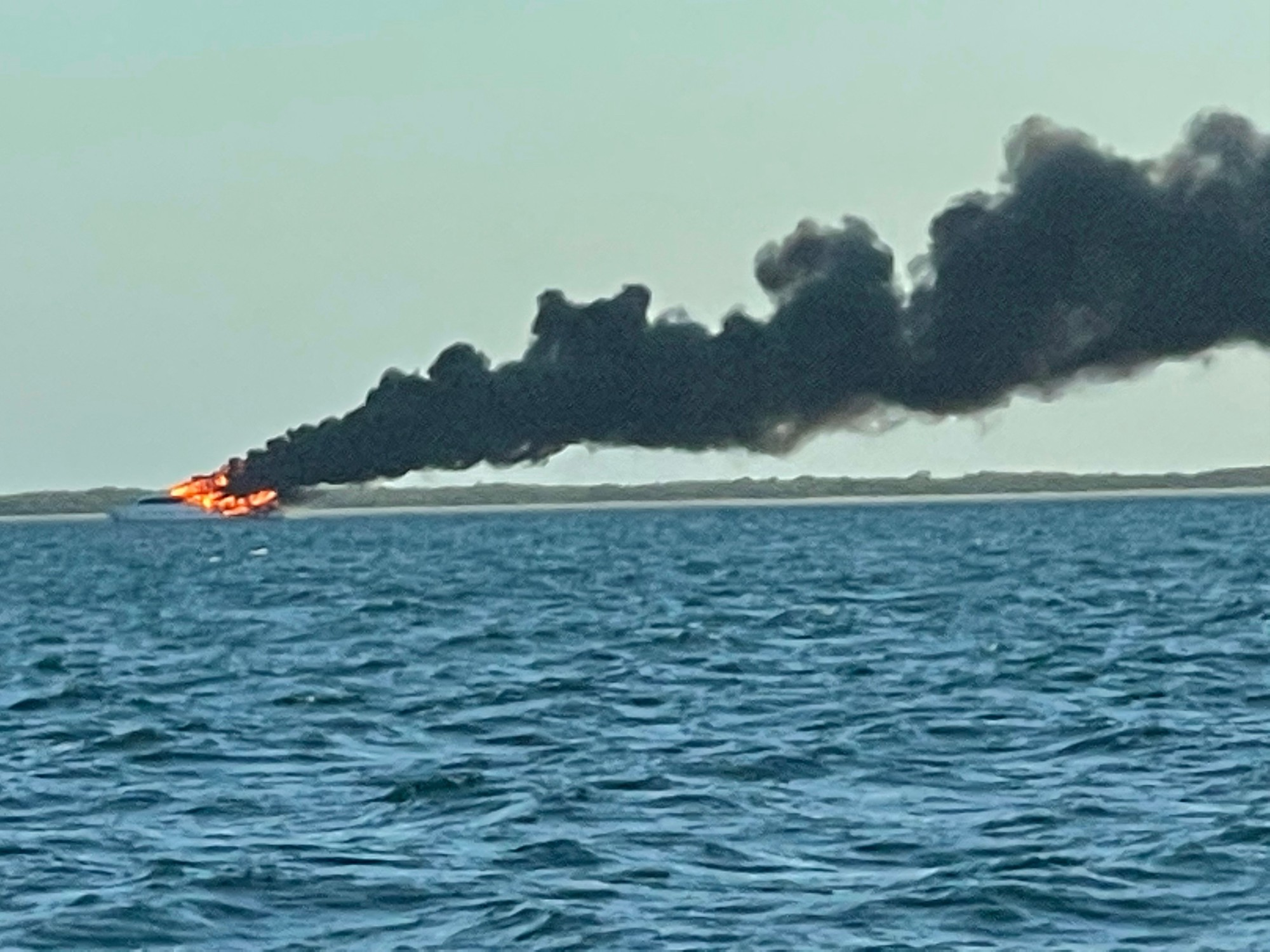Coast Guard oversees diesel spill clean-up near Marquesas after yacht fire