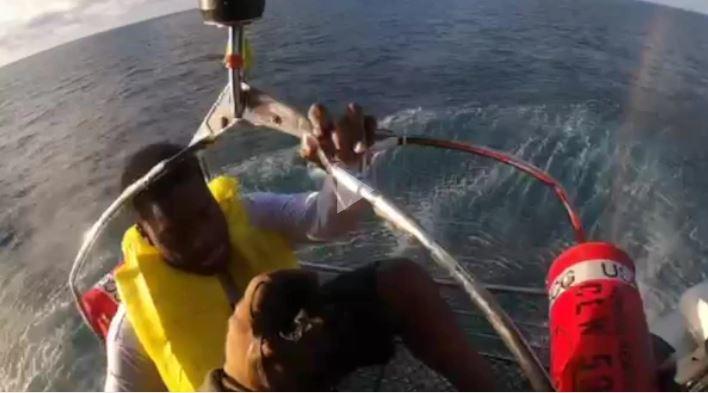 Man hoisted from overturned boat