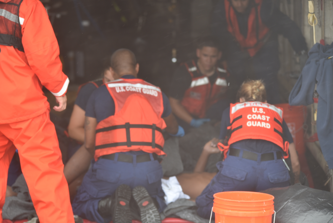 Coast Guard, good Samaritanrescue 13 from water near Key West
