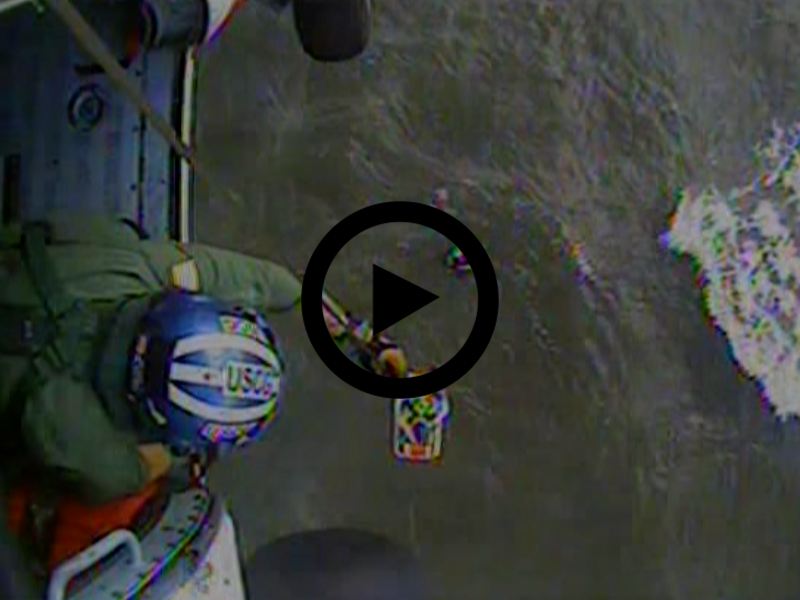 Hoist footage from the helicopter air crew from Air Station Elizabeth City as they rescue three stranded mariners.