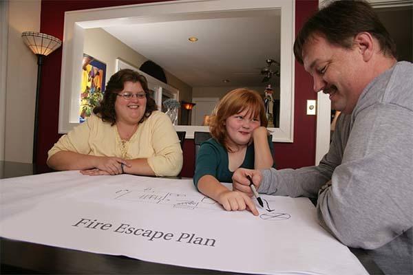family making a fire escape plan