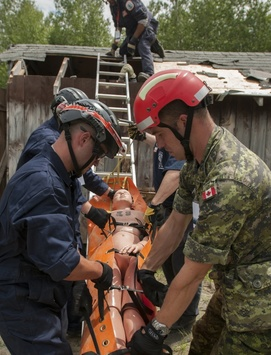 FEMA Urban Search and Rescue Task Force collaborate with Vigilant Guard through an exercise held in Camp Ethan Allen Training Site in Jericho, Vt.