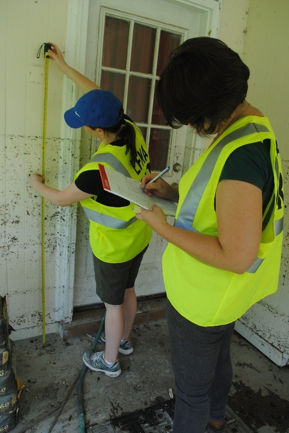 LFMA DRT volunteers collect high-water mark measurements on a flooded house, during the August 2016 flood.