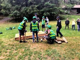 Campers at the FEMA Region 10 Youth Preparedness practice cribbing.