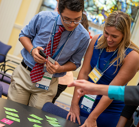 Two FEMA Youth Preparedness Council members work together for a tabletop exercise