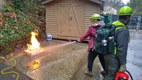 UW-Bothell/Cascadia College Campus CERT practicing extinguishing a fire, a part of CERT Basic Training: Fire Safety and Utility Controls Unit.