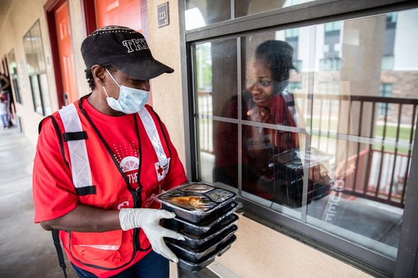 redcross woman hands out food