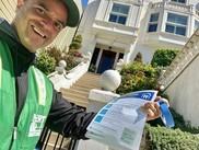 Neighborhood Emergency Response team volunteer passing around COVID-19 flyers in San Francisco.