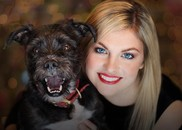 A picture of woman and dog smiling.