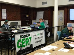 Hoboken, NJ CERT supporting staff center, answering calls related to COVID-19 assistance.