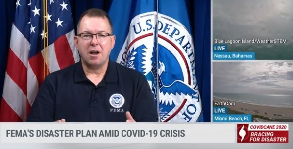 The Weather Channel: Administrator speaking in front of U.S. & D.H.S. flags, alongside live weather in Nassau, Bahamas & Miami Beach, Florida.