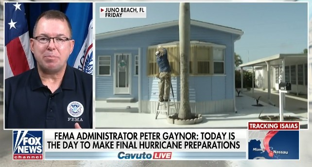 Fox News: Administrator speaking in front of U.S. & D.H.S. flags. Individual installing window protection to home exterior in Juno Beach, Florida.