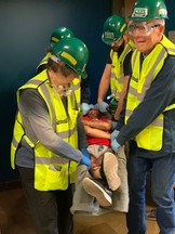 CERT members lift injured victim to safety during class