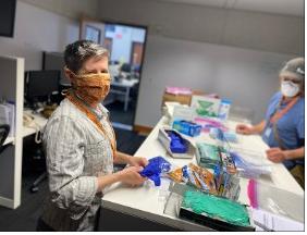 NET members prepare mask distribution