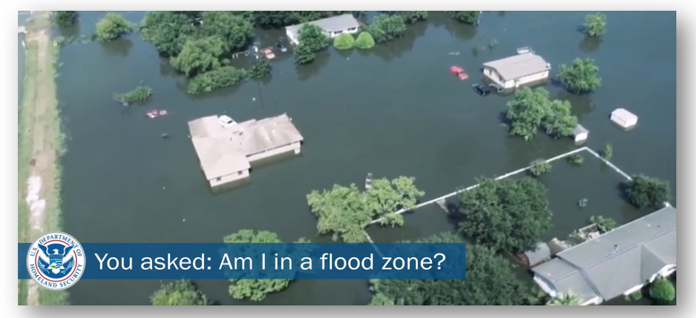 """Flooded property with water all round homes. FEMA logo. Text says """"You asked: Am I in a flood zone?"""""""
