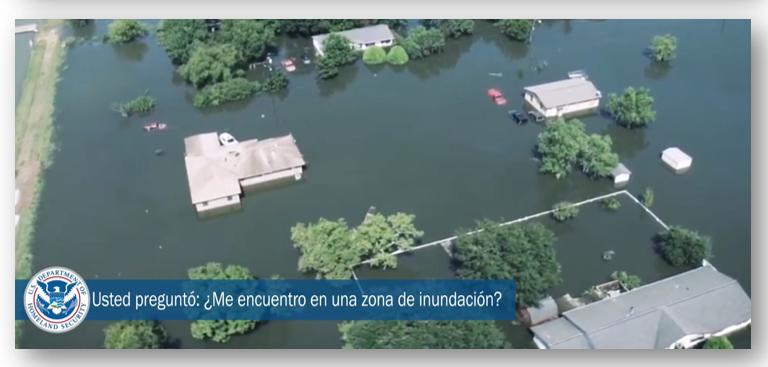 "Flooded property. Water all around homes. FEMA logo and text that says, ""Usted pregunto: ¿Me encuentro en una zona de inundación?"""