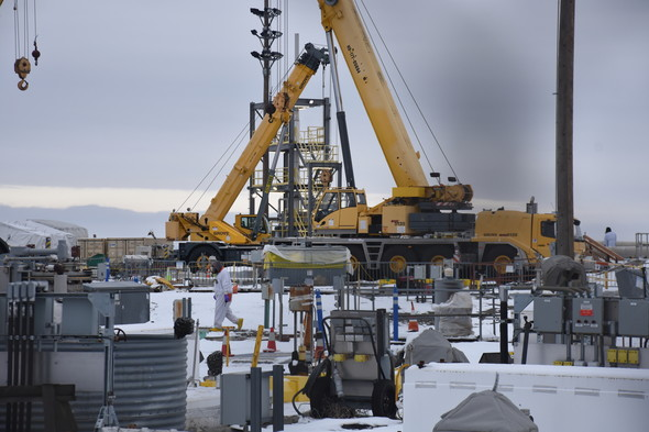 Photo shows workers retrieving waste from single-shell tank AX-104 at the Hanford Site.
