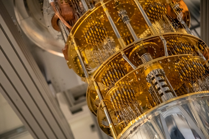 Photo of a quantum computer, a gold and metal machine hanging down
