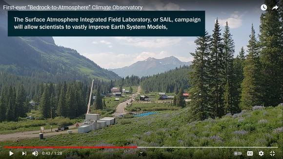 """Video screenshot of a mountain area that says """"The Surface Atmosphere Integrated Field Laboratory, or SAIL, campaign will allow scientists..."""""""