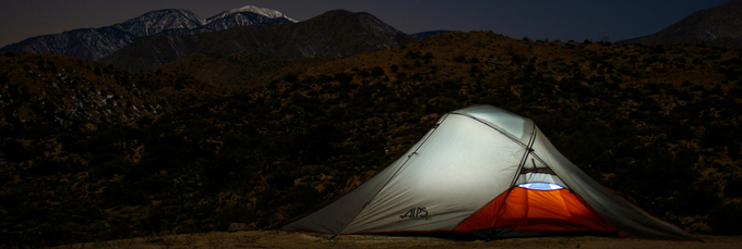 Night sky camping with illuminated tent