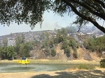 Helicopter hovering near snell fire