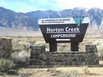 Horton Creek campground sign.  Mountains in background
