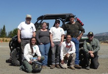 6 blm employees kneel in front of ohv