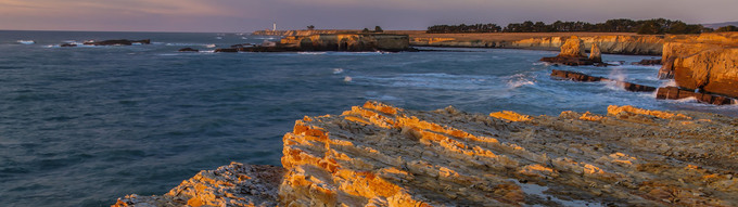 Ca Point arena stornetta. Coast and light house in distance during sunset