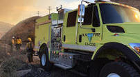 BLM yellow fire engine during sunset