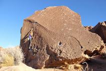 person climbing rock fixture