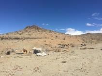 Trash on desert hillside