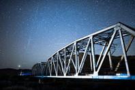 Night sky photo of afton canyon bridge